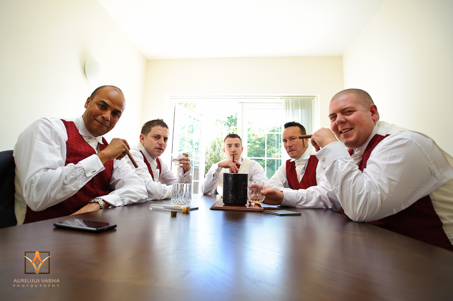 groom with 4 best man at the table smoking cigars